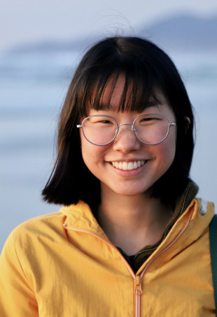 Bailey smiling in front of a beach. Student-supplied profile photo due to COVID-19. Thank you, Ba...