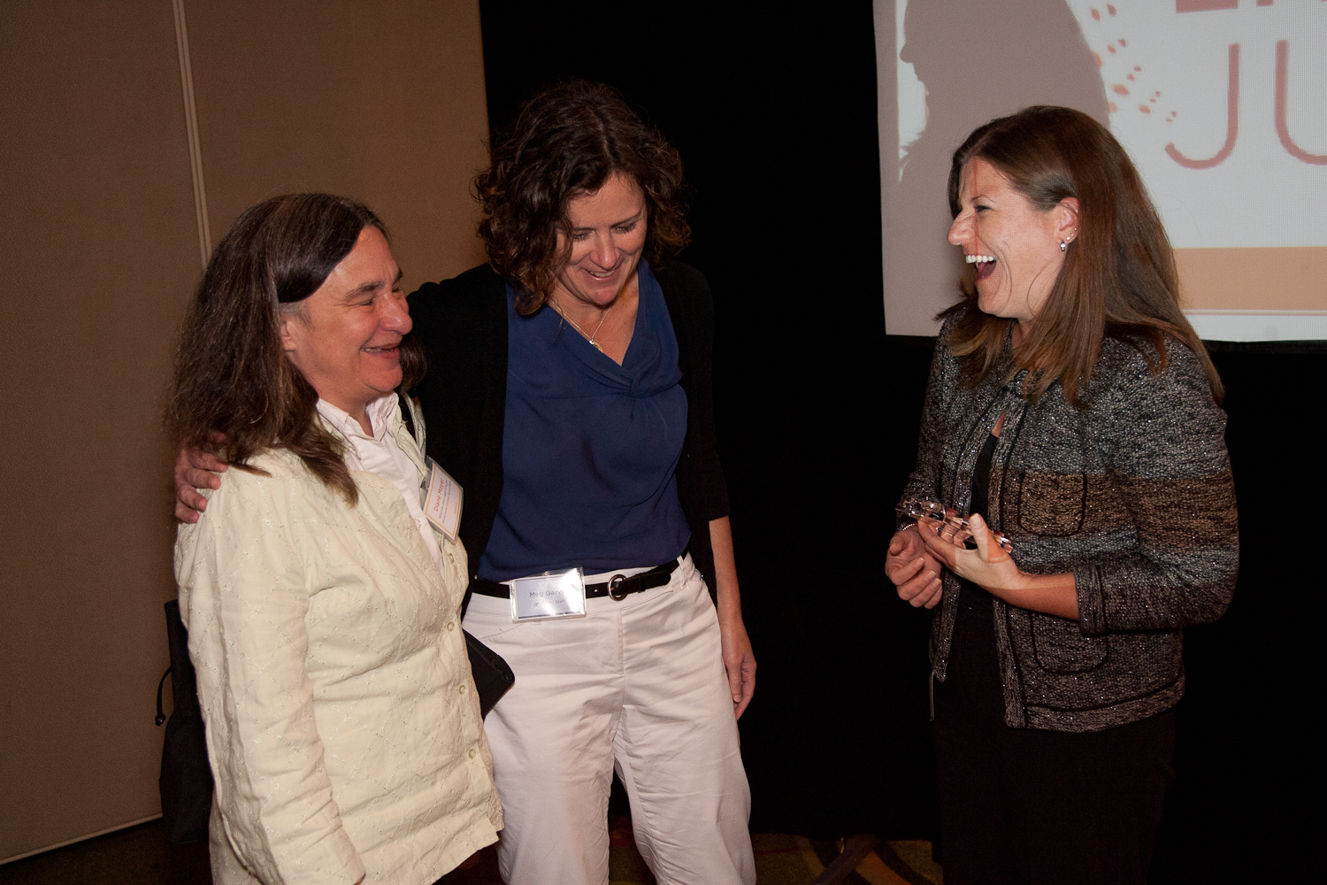 Meg Garvin laughs with NCVLI Board Member Diane Moyer and recipient of the 2012 Gail Burns-Smith Excellence in Victim Service Award, Jennifer Storm.