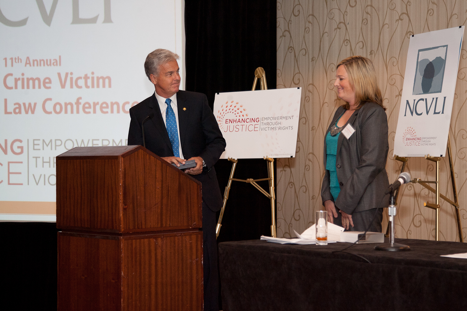 Mitch Morrissey of the Denver District Attorney's Office and Lisa Teesch-Maguire of the Rocky Mountain Victim Law Center accept the 2012 Victims' Rights Partnership Award on behalf of their respective organizations.