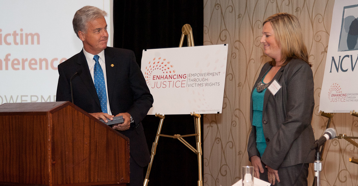 Mitch Morrissey of the Denver District Attorney's Office and Lisa Teesch-Maguire of the Rocky Mountain Victim Law Center accept the 2012 Victims' Rights Partnership Award at the 11th Annual Crime Victim Law Conference.