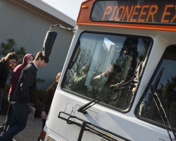Students board the PioExpress for easy transportation.