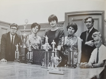 George Austin (left), Jean Ward (third from left), Neil Sabin (right), along with members of the L&C team