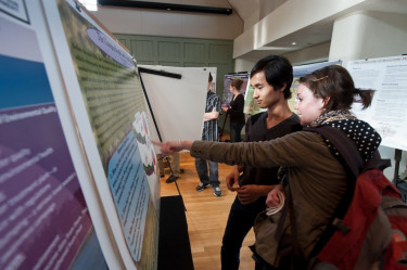 Beyond conducting research, we ask students to present their findings in poster sessions like thi...