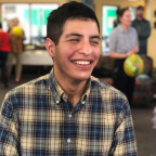 Pedro Ramos is smiling; wearing a blue and yellow plaid shirt.