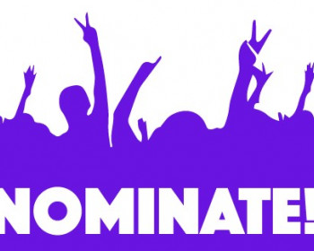 Image of hands raised above the word NOMINATE.