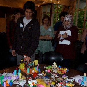 Students talk about their cities in the Build a City Workshop.  Photo by James Rojas.
