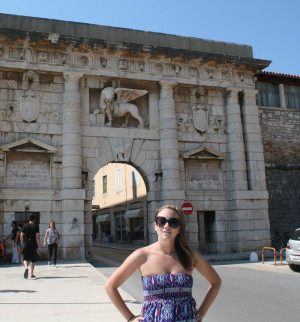 Kelly did some traveling (pictured in Zadar, Croatia) before settling into graduate school at Cla...