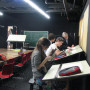 Student designers at work on a Theatre Graphics project