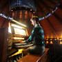 Chris Keady B.A. '10 plays the circular pipe organ in the Agnes Flanagan Chapel. (AP Photo/Rick...