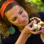 Lily Clarke examines some of the mushrooms she studies.